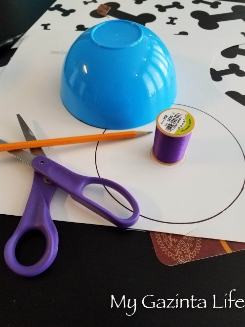 Supplies: plastic placemats, scissors, small bowl & thread spool to trace, scissors, Sharpie marker and pencil
